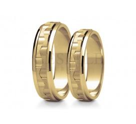 Nowoczesna para obrączek ślubnych z 14 karatowego złota o ciekawej strukturze i wykończeniu
