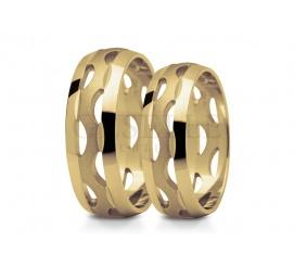 Ultranowoczesna para obrączek ślubnych z żółtego złota - ażurowa baza o niestandardowym kształcie
