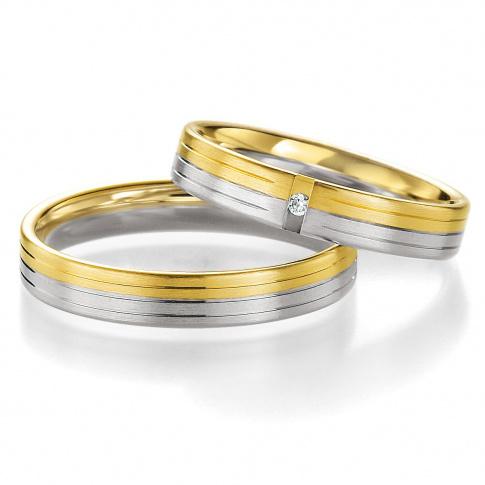 Subtelny duet złotych obrączek ślubnych z białego i żółtego kruszcu z lśniącym brylantem