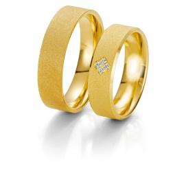 Szeroki komplet obrączek ślubnych z żółtego złota próby 333 z czterema brylantami