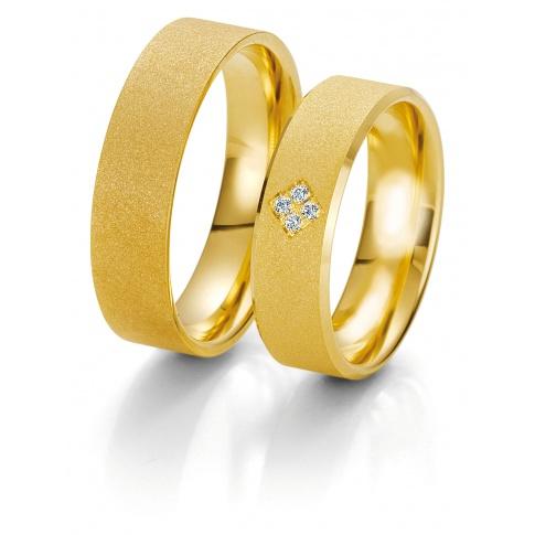 Szeroki komplet obrączek ślubnych z żółtego złota z czterema brylantami