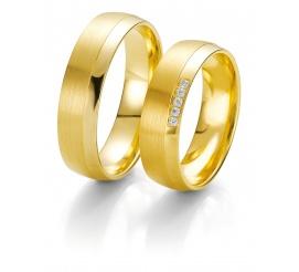Masywne, złote obrączki ślubne Breuning z rzędem wiecznych brylantów