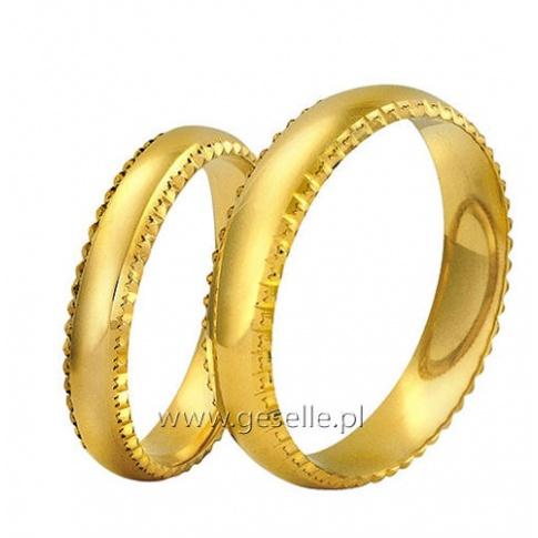 Tradycyjne obrączki z klasycznego złota z ozdobnymi krawędziami