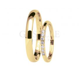 Niezwykły komplet obrączek ślubnych Eternity z żółtego złota z siedmioma cyrkoniami