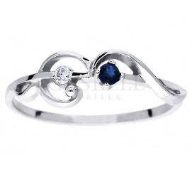 Niezwykły pierścionek z giętą szyną z białego złota, lśniącym brylantem i eleganckim szafirem