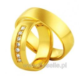 Cieszący się niesłabnącym powodzeniem ponadczasowy wzór obrączek ślubnych z klasycznego złota z rzędem cyrkonii Swarovski ELEMENTS