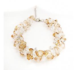 Przyciągająca uwagę srebrna bransoletka z kryształami Swarovski Elements w zjawiskowym odcieniu Crystal Golden Shadow