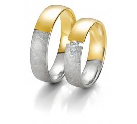 Dwukolorowa damska obrączka - połowa z białego, połowa z żółtego złota i trzy brylanty
