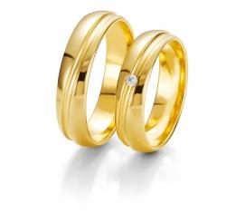 Klasyczna damska złota obrączka Breuning z subtelną linią i lśniącym brylantem