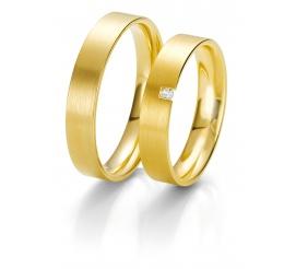 Klasyczna damska złota obrączka ślubna z brylantem o masie 0,03 ct