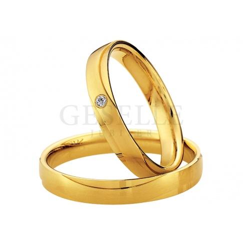 Delikatna damska obraczka ślubna w klasycznym stylu z kolekcji Saint Maurice z żółtego złota próby 333 z lśniącym oczkiem