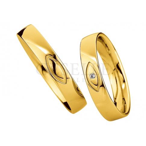 Niebanalna męska obrączka z żółtego złota - fantazyjne nacięcie