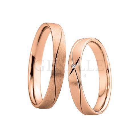 Niebanalna damska obrączka ślubna z różowego złota próby 333 z lśniącym, brylantowym oczkiem