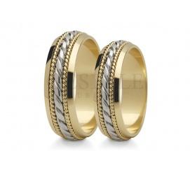 Romantyczne obrączki ślubne z dwóch kolorów złota z wspaniałym zdobieniem na szynie