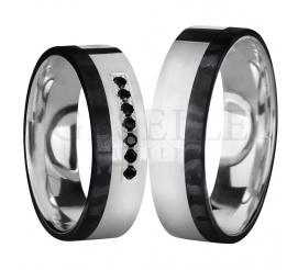Nowoczesna elegancja - prezentujemy obrączki ślubne wykonane z karbonu w połączeniu ze srebrem, projekt wieńczą czarne cyrkonie Swarovski Elements w oprawie jubilerskiej