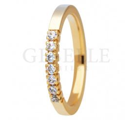 Niebanalny pierścionek ESSENCE II z siedmioma brylantami po 0.03 ct w całości wykonany z żółtego złota próby 585