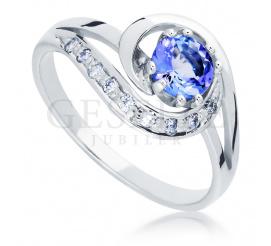 Zjawiskowy pierścionek z białego złota próby 585 z tanzanitem i wiecznymi brylantami o masie 0,09ct
