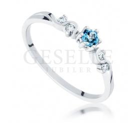 Pierścionek zaręczynowy z białego złota w stylu Retro - topaz blue i brylanty