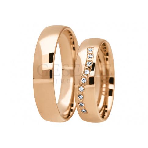 Wyjątkowy komplet obrączek ślubnych z 14-karatowego złota  z olśniewajacymi cyrkoniami Swarovski Elements lub brylantami