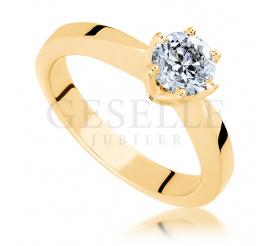 Olśniewający pierścionek z żóltego złota z wiecznym brylantem 0,70 ct