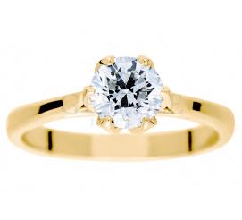 Lukusowy pierścionek zaręczynowy z niezwykłym brylantem o masie 0,90 ct z żółtego złota