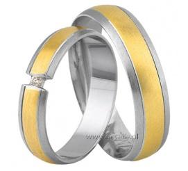 Wyjątkowe obrączki ślubne z białego i żółtego złota próby 585 z niestandardowo zawieszonym kamieniem