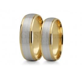 Półokrągłe, dwukolorowe obrączki ślubne od GESELLE Jubiler; białe i żółte złoto w klasycznym wydaniu