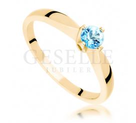 Niezwykle uroczy pierścionek z topazem wykonany z żółtego złota próby 585
