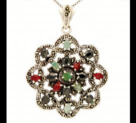 Interesująca zawieszka w kształcie kwiatu z naturalnymi kamieniami wykonana w całości ze srebra