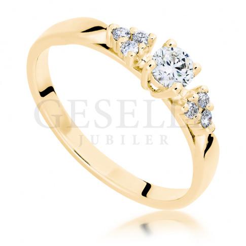 Oryginalny pierścionek z żółtego złota z brylantami o całkowitej masie 0,25 ct