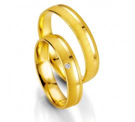 Klasyczne obrączki ślubne z żółtego złota z brylantem firmy Breuning