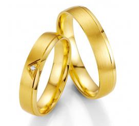 Obrączki ślubne z żółtego złota z brylantem oprawionym w trójkąt firmy Breuning