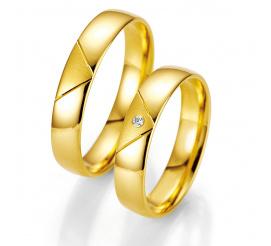 Klasyczne obrączki ślubne ze złota z brylantem od firmy Breuning