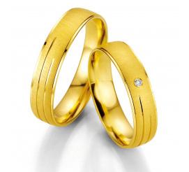 Zachwycające obrączki ślubne z żółtego złota z brylantem 0,015 ct