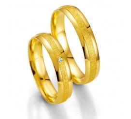 Ponadczasowe obrączki ślubne z żółtego złota z brylantem firmy Breuning
