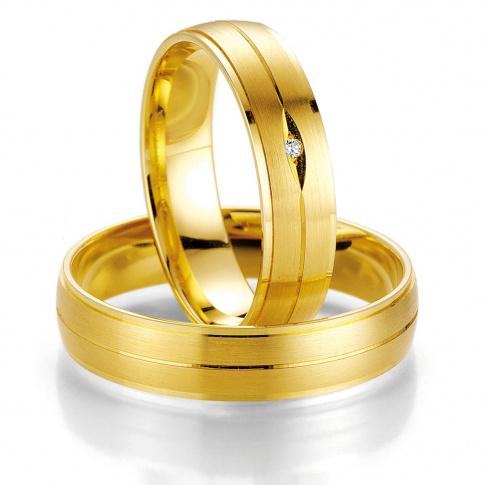 Klasyczne i eleganckie obrączki ślubne z żółtego złota z brylantem