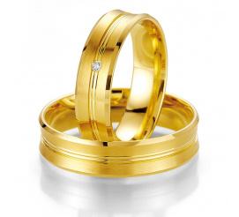 Eleganckie obrączki ślubne z żółtego złota z delikatną linią i brylantem