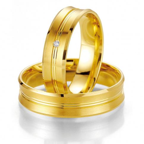 Eleganckie obrączki ślubne z żółtego złota próby 585 z delikatną linią i brylantem