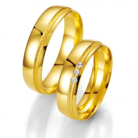 Solidne obrączki ślubne Breuning z klasycznego kruszcu z rzędem brylantów