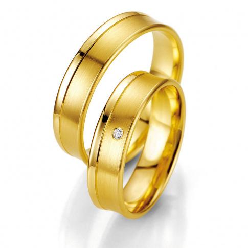 Niezwykle stylowy komplet obrączek z żółtego złota z pełnym blasku brylantem