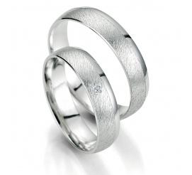Pełne prostoty i elegancji obrączki ślubne z białego złota z polerowaną krawędzią