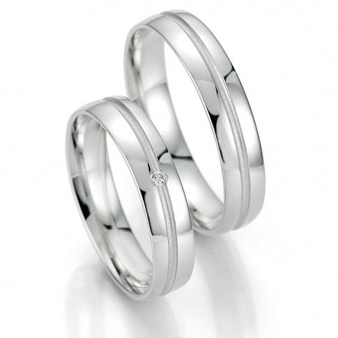 Ponadczasowe obrączki ślubne z białego złota z brylantem na delikatnej linii