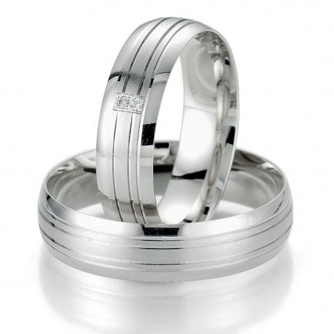 Ponadczasowy komplet obrączek ślubnych z białego złota z delikatnymi liniami