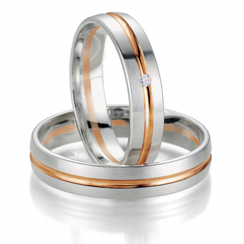 Bardzo popularne obrączki ślubne Breuning - pełne blasku białe złoto i czerwona linia z lśniącym brylantem