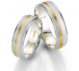 Luksusowe, dwukolorowe obrączki ślubne z białego i żółtego kruszcu firmy Breuning