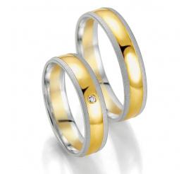 Ponadczasowy komplet obrączek ślubnych z białego i żółtego złota z lśniącym brylantem