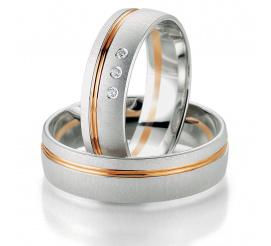 Solidny komplet dwukolorowych obrączek ślubnych Breuning z trzema brylantami