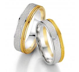 Matowe obrączki ślubne Breuning z białego i żółtego złota z polerowanymi liniami