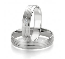 Eleganckie i stylowe obrączki weselne - białe złoto próby 585 - subtelnie dekorowana szyna i brylanty