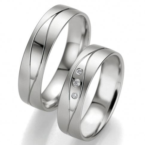 Romantyczne obrączki weselne z delikatną, brylantową łezką na polerowanej powierzchni z białego złota